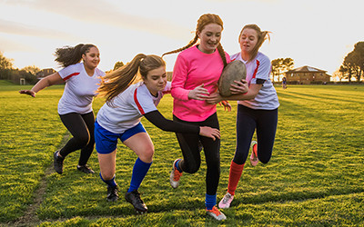 Photo of girls playing rugby